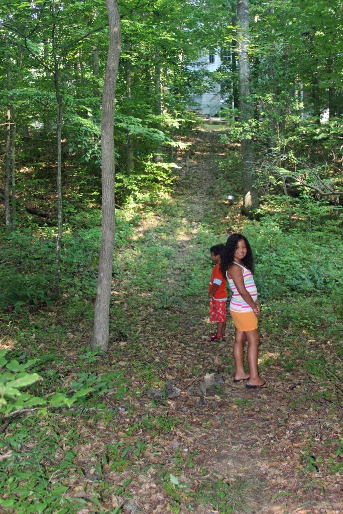 Aidan & Bella on path to creek.